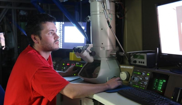 Dr Jonathan Hinks studies his research on the MIAMI microscope