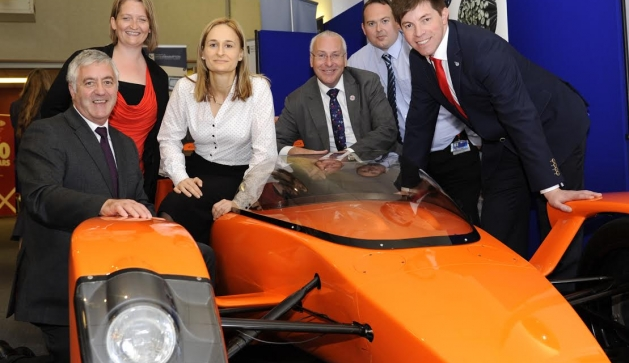 Delegates gather around the Caparo T1 at The Made in the Midlands Exhibition 2014